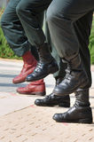 Army Boots Stand Out in a Crowd Stock Photo
