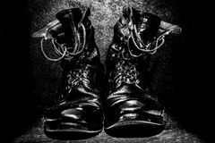 Army boots of a veteran, memories, everlasting companion of a veteran. Veteran boots of a parachutist special forces. They have seen and felt a lot keeping the Stock Photos