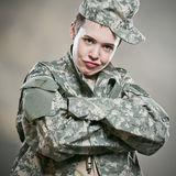 Army Brat. A female US army soldier Royalty Free Stock Photo