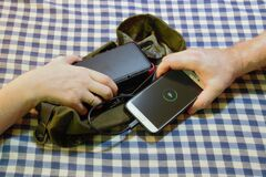 Army bushcraft survival solar power bank sharing charge to charge someones mobile cell phone