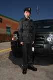 Army Cadet. Canadian Army cadet in uniform, standing in front of vehicle, brick building in background Stock Photo