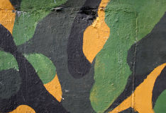 Army camouflage colors. Wall painted in army camouflage colors - yellow, green and black Royalty Free Stock Image