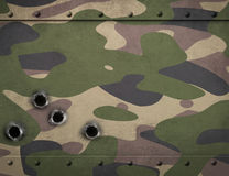 Army camouflage metal armor with bullet holes 3d illustration Royalty Free Stock Image