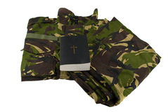 Army camouflage uniform and bible Royalty Free Stock Photo