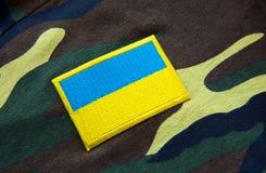 Army camouflage uniform with Ukraine yellow-blue flag Stock Image