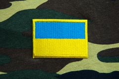Army camouflage uniform with Ukraine yellow-blue flag Stock Photos