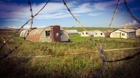 Army Camp Behind Razor Wire Fence Stock Photography