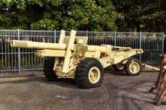Army cannon in desert camouflage. Wargun. Defensive position howitzer. Stock Photography