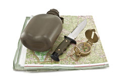 Army canteen, a knife and a compass are on the map. Isolated on white background Stock Image