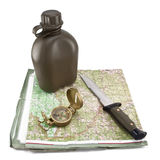 Army canteen, a knife and a compass are on the map. On white background Stock Images