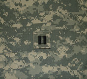 Army Captain Rank on ACU. United States Army Captain Rank on an ACU background royalty free stock image