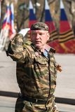 Army captain salutes on Victory Day parade Royalty Free Stock Photo