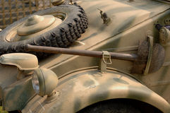 Army Car. Old army car with spare tire on hood, rusty shovel attached, tan colored stock images