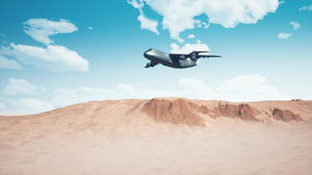 Army cargo aircraft flying low over sandy desert 4K. Army cargo transportation aircraft flying low over abstract sandy desert in a blue cloudy sky at daytime stock footage