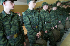 Army conscripts receiving military uniform Stock Photos