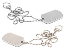 Army dog tags. Pair of dog tags or identity plates with copy space over white background Royalty Free Stock Photos