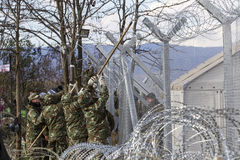 The army of F.Y.R. of Macedonia continues the fence construction Stock Photos
