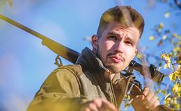 Army forces. Camouflage. Bearded man hunter. Hunting skills and weapon equipment. How turn hunting into hobby. Military. Uniform fashion. Man hunter with rifle royalty free stock photo