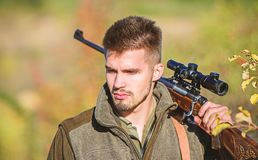 Army forces. Camouflage. Bearded man hunter. Hunting skills and weapon equipment. How turn hunting into hobby. Military. Uniform fashion. Man hunter with rifle royalty free stock photography