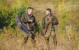 Army forces. Camouflage. Friendship of men hunters. Hunting skills and weapon equipment. How turn hunting into hobby. Military uniform fashion. Man hunters royalty free stock photos