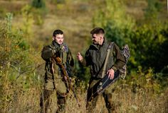 Army forces. Camouflage. Friendship of men hunters. Hunting skills and weapon equipment. How turn hunting into hobby. Military uniform. Man hunters with rifle stock images