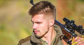 Army forces. Camouflage. Military uniform fashion. Bearded man hunter. Hunting skills and weapon equipment. How turn. Hunting into hobby. Man hunter with rifle royalty free stock image