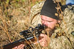 Army forces. Camouflage. Military uniform fashion. Bearded man hunter. Hunting skills and weapon equipment. How turn. Hunting into hobby. Man hunter with rifle royalty free stock photos