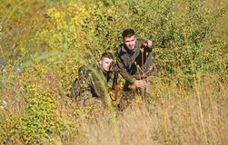 Army forces. Camouflage. Military uniform fashion. Friendship of men hunters. Hunting skills and weapon equipment. How. Turn hunting into hobby. Man hunters stock photo