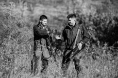 Army forces. Camouflage. Military uniform fashion. Friendship of men hunters. Hunting skills and weapon equipment. How. Turn hunting into hobby. Man hunters stock image