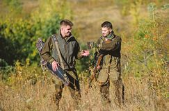 Army forces. Camouflage. Military uniform fashion. Friendship of men hunters. Hunting skills and weapon equipment. How. Turn hunting into hobby. Man hunters royalty free stock images