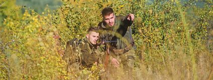 Army forces. Camouflage. Military uniform fashion. Man hunters with rifle gun. Boot camp. Hunting skills and weapon. Equipment. How turn hunting into hobby royalty free stock photography
