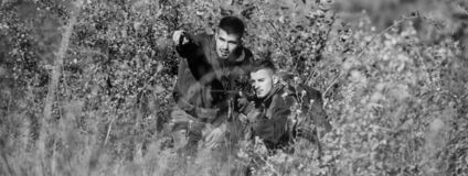 Army forces. Camouflage. Military uniform fashion. Man hunters with rifle gun. Boot camp. Hunting skills and weapon. Equipment. How turn hunting into hobby stock photo