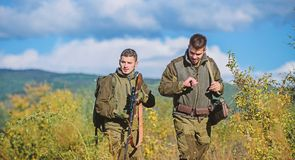 Army forces. Camouflage. Military uniform. Man hunters with rifle gun. Boot camp. Hunting skills and weapon equipment. How turn hunting into hobby. Friendship royalty free stock images