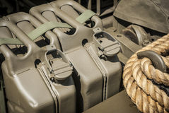 Army Fuel. Military  jerrycans strapped onto a vehicle Stock Image