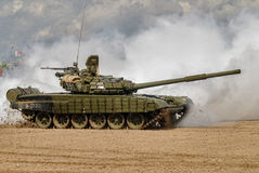 Army Games-2017. Safe Route contest. Tyumen.Russia. Tyumen, Russia - August 6, 2017: International Army Games. Safe Route contest. Tank T-72 tank in action Stock Photography