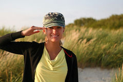 Army girl. Beautiful woman in camouflage cap Stock Images