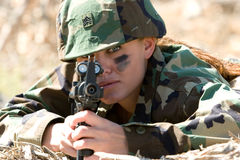 Army Girl. Young army girl pointing gun Stock Images