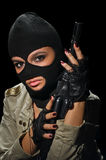Army girl in mask. Young beauty girl with machine-gun on black background Royalty Free Stock Photography
