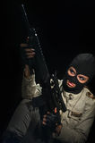 Army girl in mask. Young beauty girl with machine-gun on black background Stock Photos