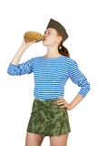 Army girl posing with flagon Stock Photo