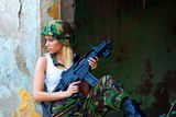 Army girl with rifle. Beautiful army girl with rifle in camouflage clothes Stock Photo