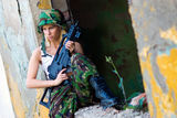 Army girl with rifle. Beautiful army girl with rifle in camouflage clothes Royalty Free Stock Photography