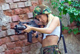 Army girl with rifle. Beautiful army girl with rifle in camouflage clothes Royalty Free Stock Photos