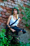 Army girl with rifle. Beautiful army girl with rifle in camouflage clothes Royalty Free Stock Images