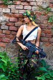 Army girl with rifle Royalty Free Stock Image