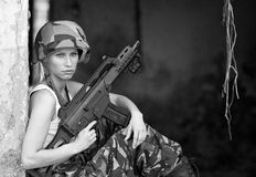 Army girl with rifle. Beautiful army girl with rifle in camouflage clothes Stock Image