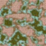 Army green and brown woodland camouflage fabric texture background Royalty Free Stock Images