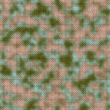 Army green and brown woodland camouflage fabric texture background Stock Photo