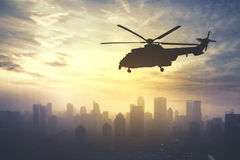 Army helicopter flying at sunrise time Royalty Free Stock Image