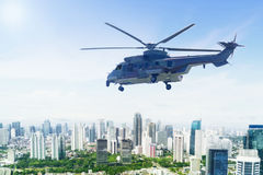 Army helicopter hovering over downtown. Image of army helicopter hovering over downtown while doing patrols Stock Photos